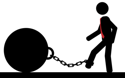Silhouette of a person strapped to a ball and chain