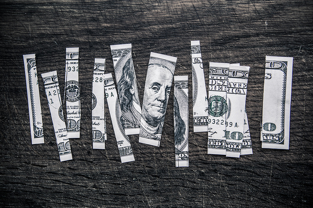 100 dollar bill ripped up